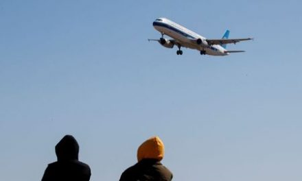 China orders sharp cuts in flights in, out of country to curb coronavirus risk